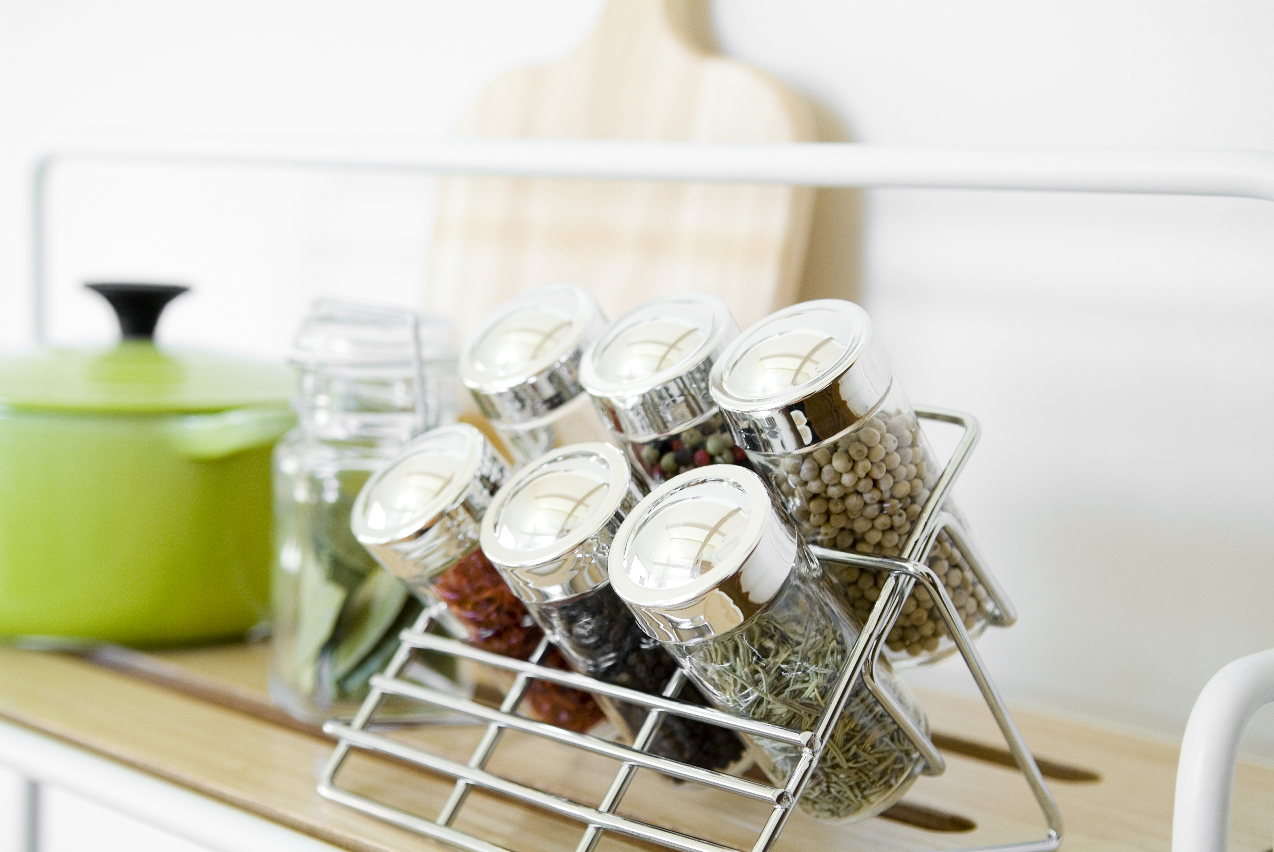 Tiered spice rack for better kitchen pantry storage.