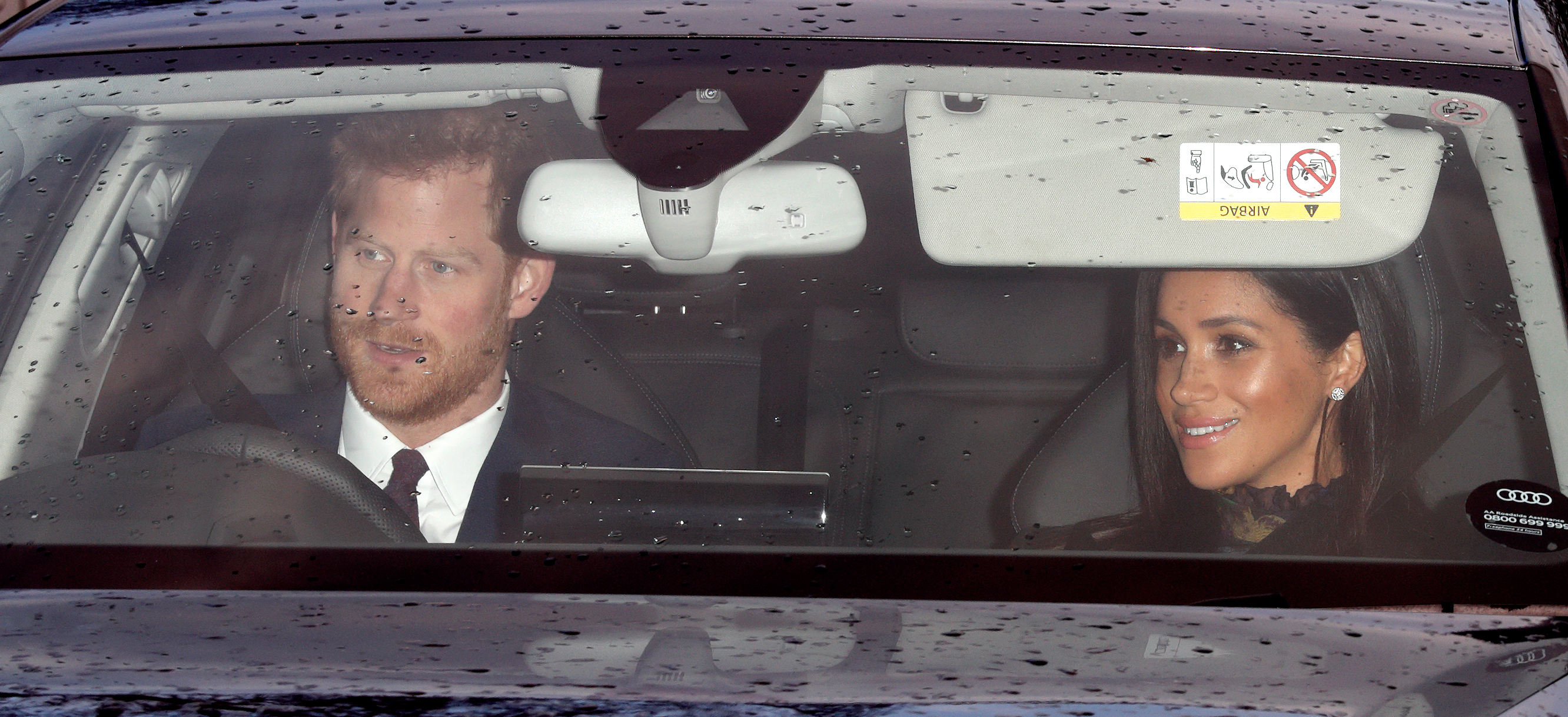 Prince Harry and Meghan Markle driving.