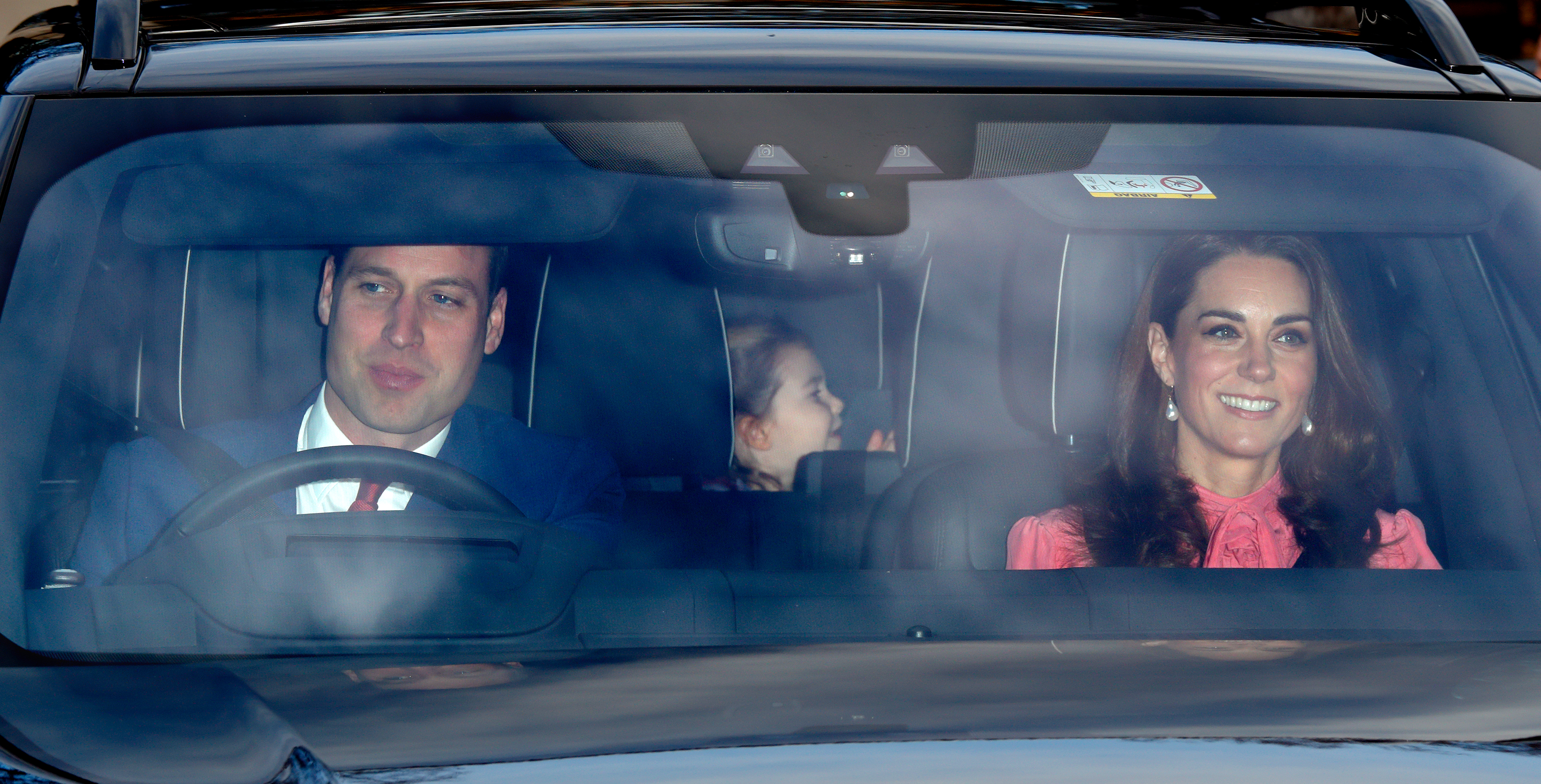 Prince William driving his family, Kate Middleton and Princess Charlotte.