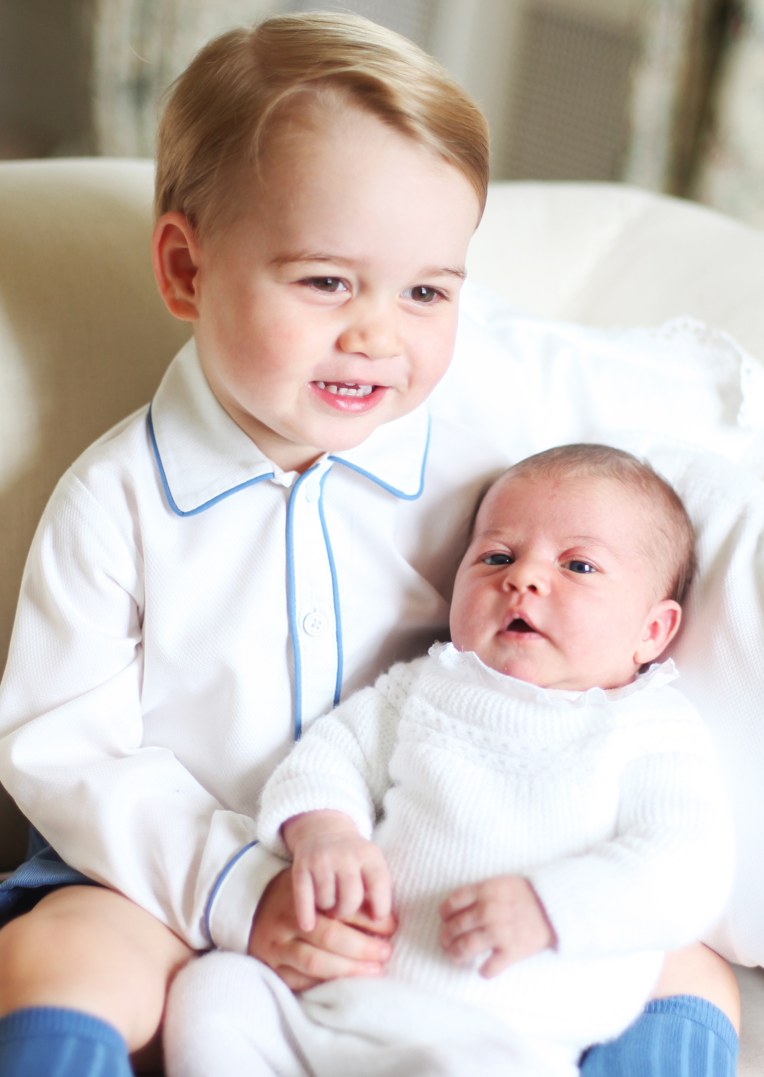 prince george holding princess charlotte