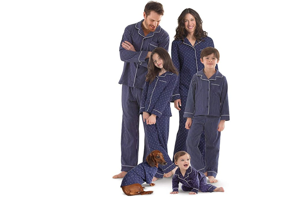 family wearing matching blue pajamas set