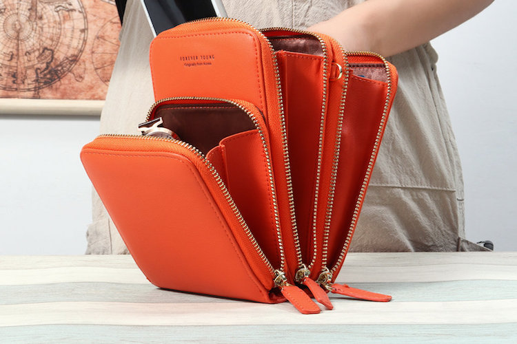 orange accordian phone crossbody fanned out