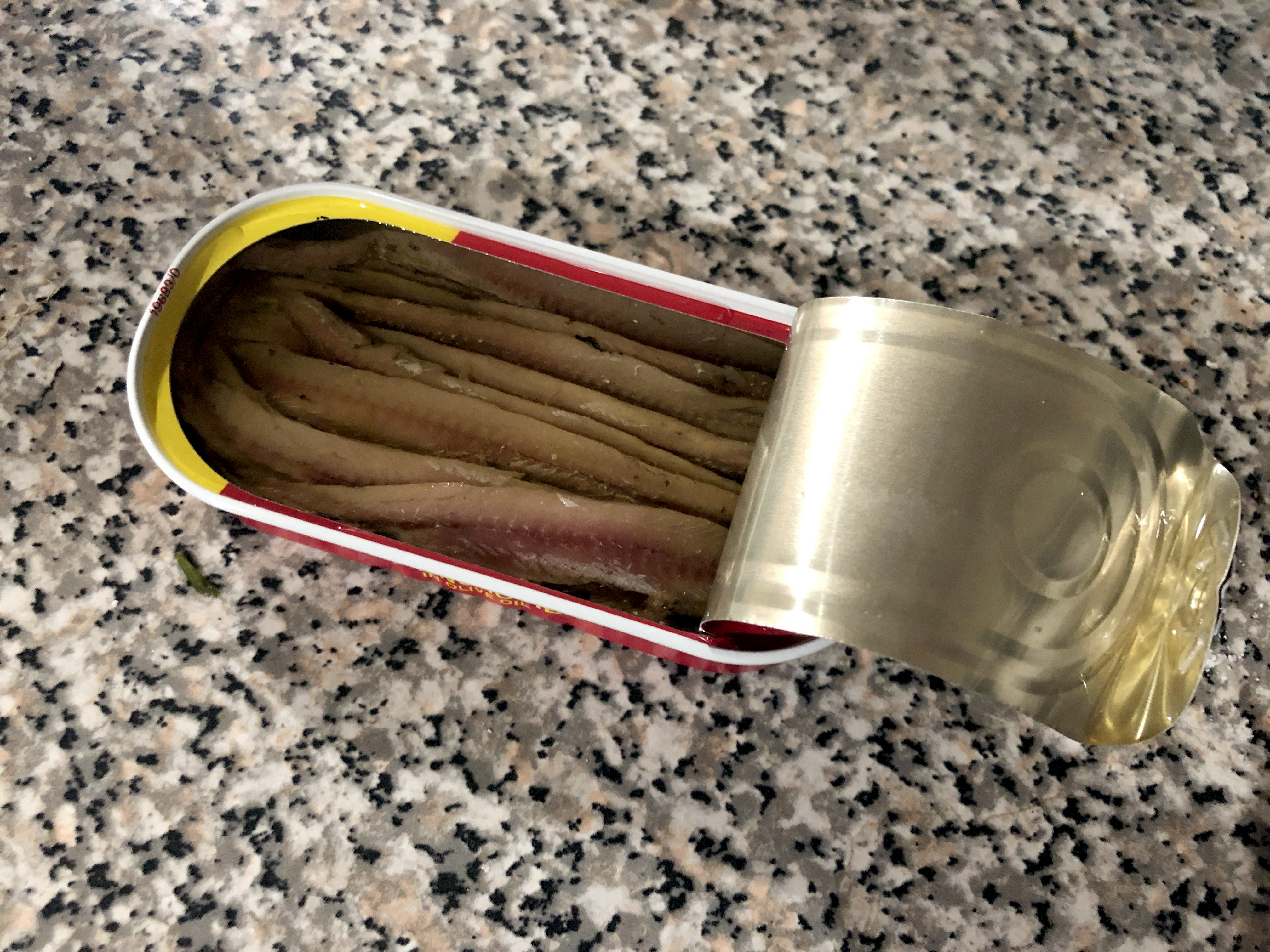 opened can of anchovies