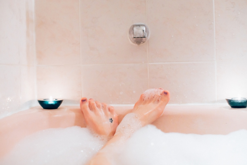 woman's feet sticking out from a bubble bath