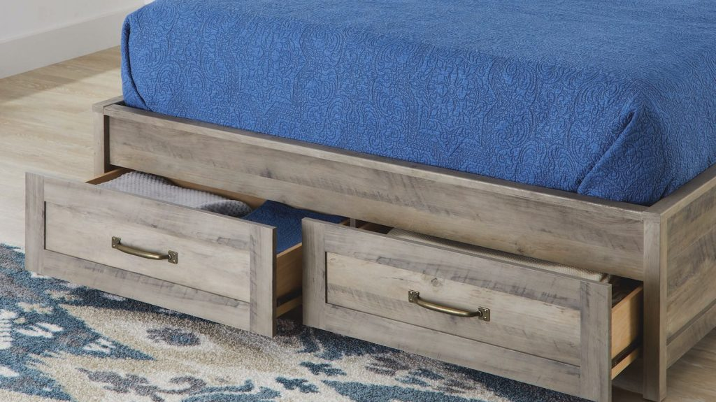 bottom of a wooden farmhouse bed