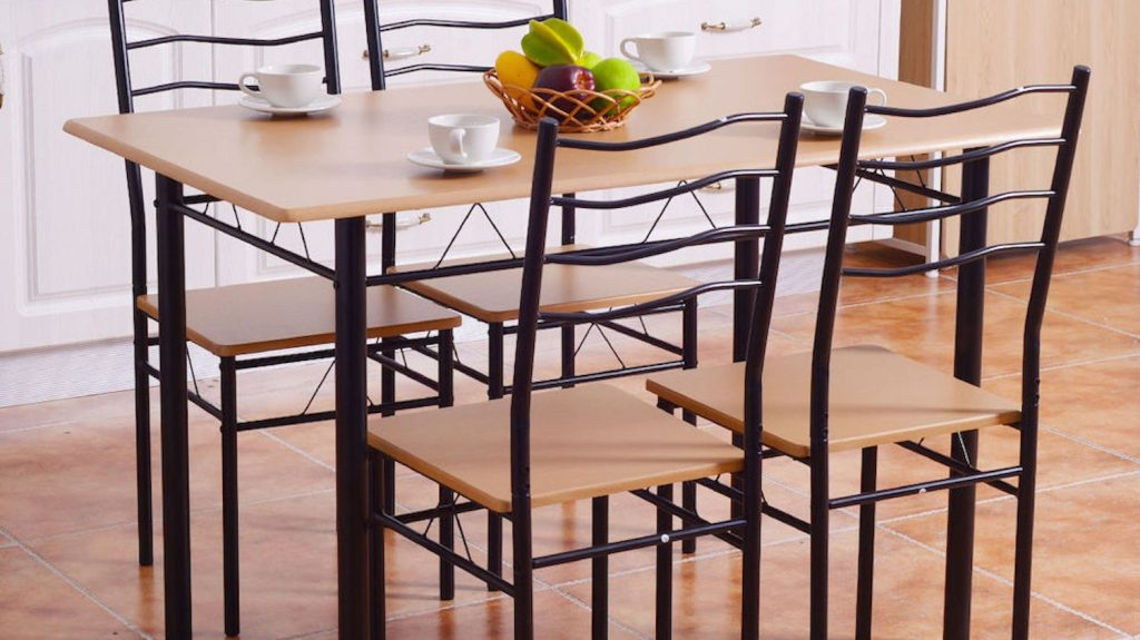 table and four chairs in a light kitchen setting