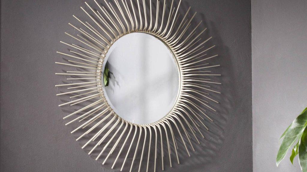 sunburst wall mirror on gray wall