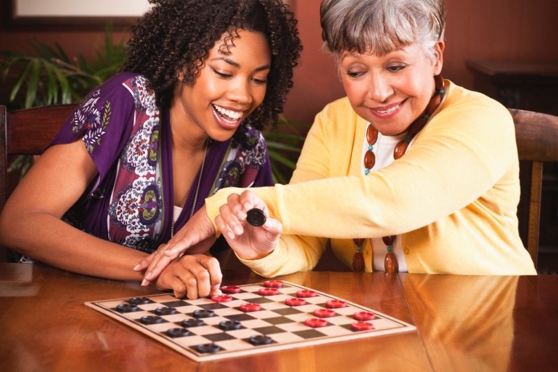 African American woman and her mother playing checkers