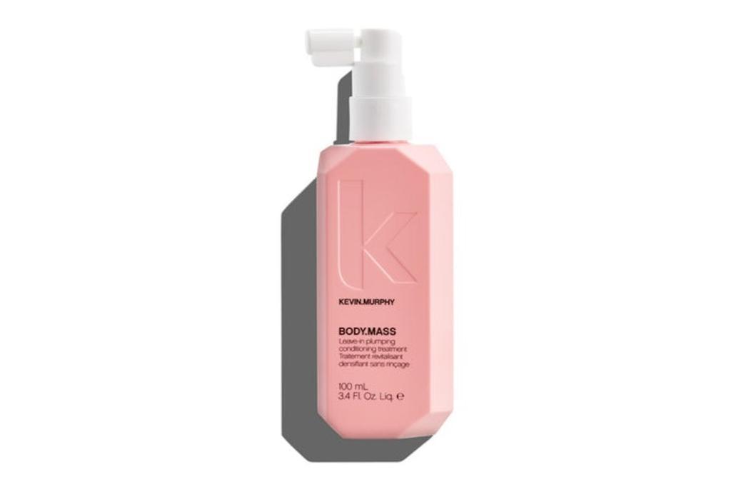 pink bottle of hair thickening spray