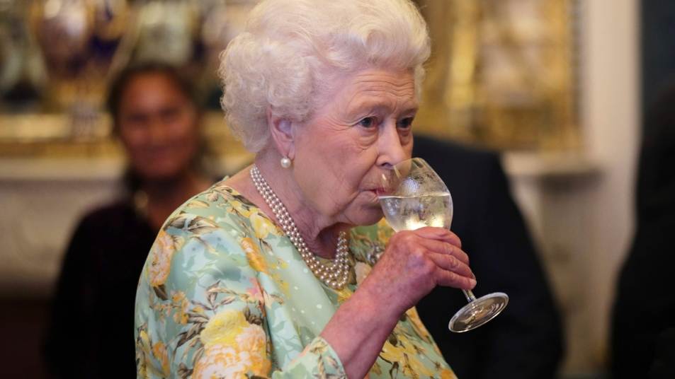 Queen Elizabeth sipping water from glass
