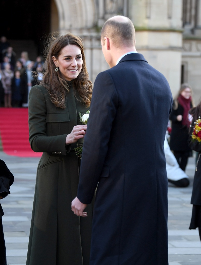 kate middleton receiving flowers from Prince William