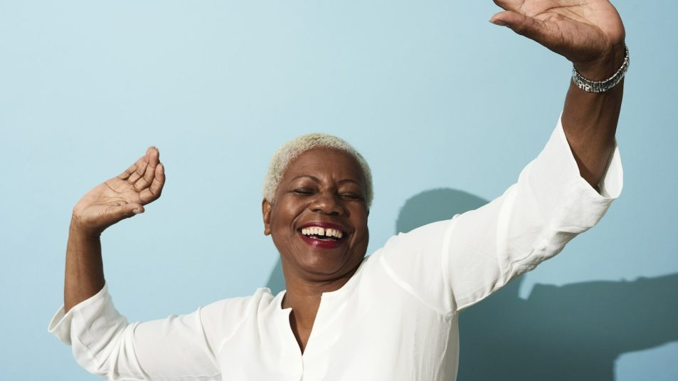 Portrait of mature woman dancing, smiling and having fun