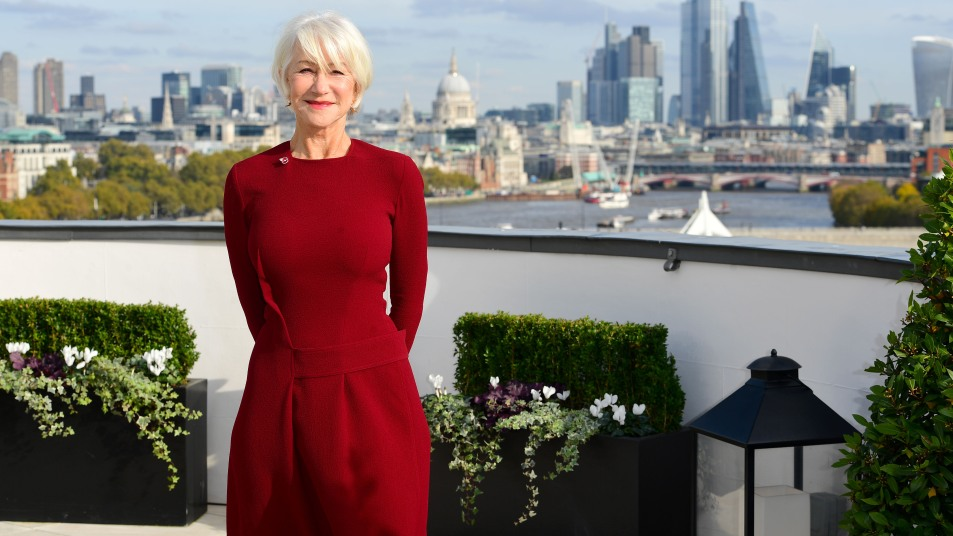 helen mirren red dress with city skyline