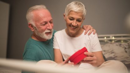 Mature couple holding a gift box