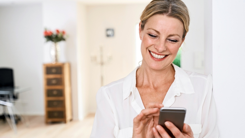 Woman smiling at her phone