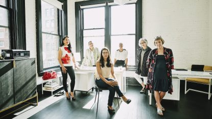 Group portrait of businesswomen in creative office
