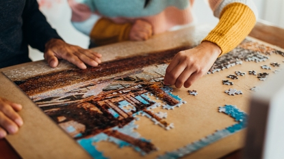 hands doing a jigsaw puzzle