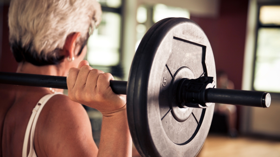 Older woman lifting weight
