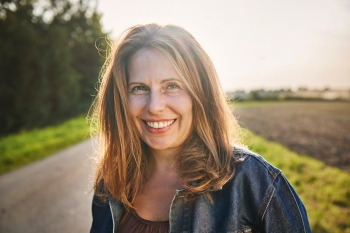 Portrait of smiling woman in the countryside