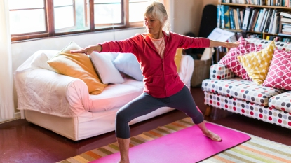 Woman doing yoga in living room