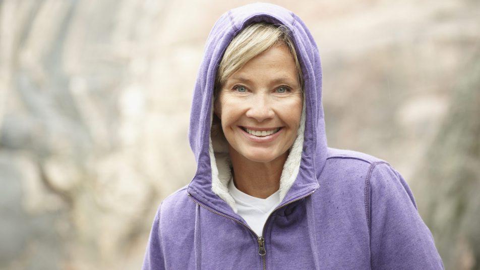 Mature woman in purple hoodie