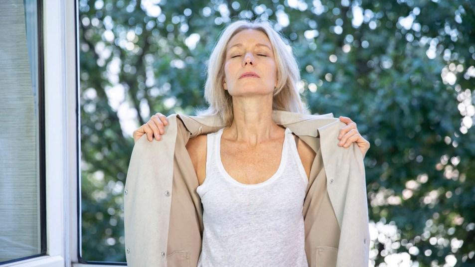 A menopausal woman having a hot flash