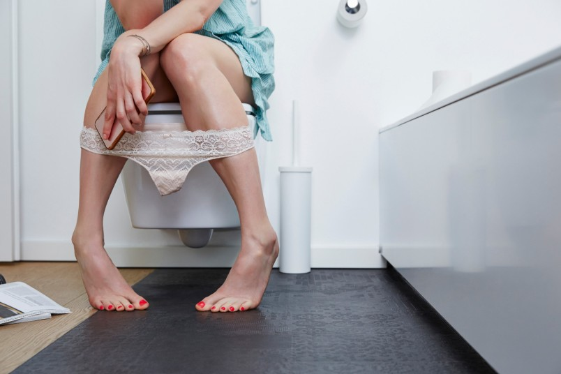 woman on the toilet with phone