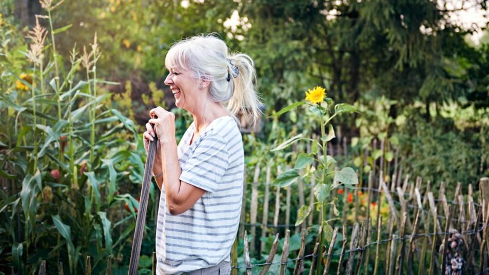 Woman smiling in her garden