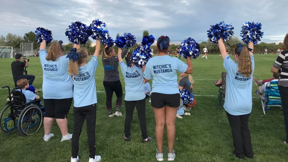 Mitchie's Mustangs cheering at a community event