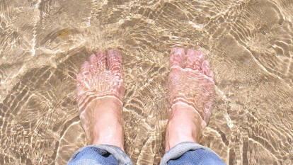 feet in the water at the beach