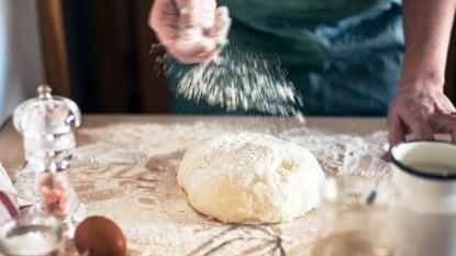 Woman making pizza dough