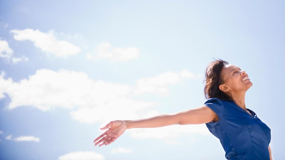 Black woman basking in sunshine