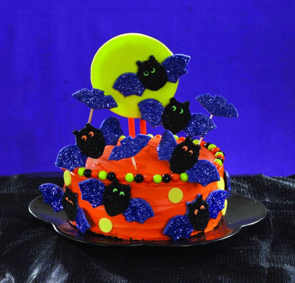 Orange cake with candy bats