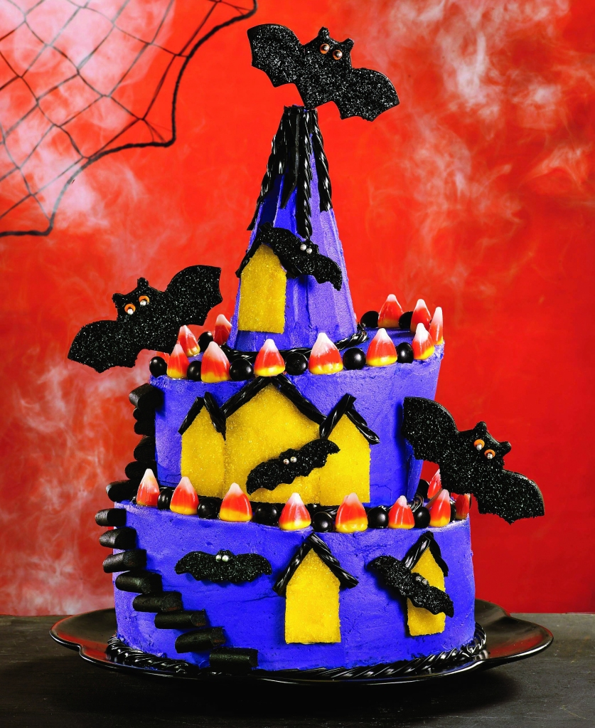 Purple cake in the shape of a haunted house