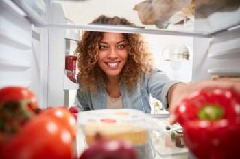 looking in fridge full of food