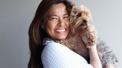 Smiling woman holding Yorkshire terrier