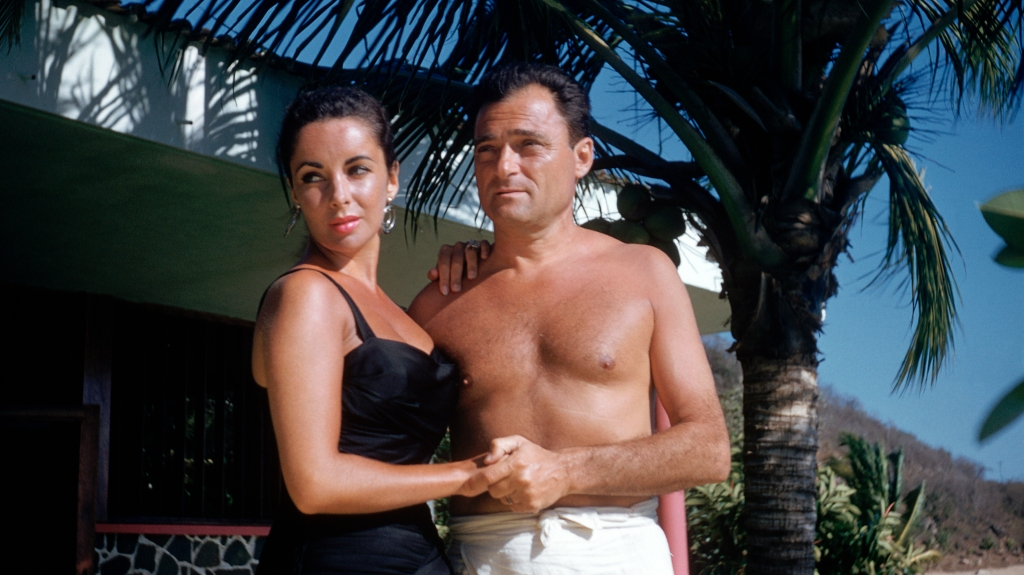 Elizabeth Taylor and Michael Todd in swimsuits on their honeymoon