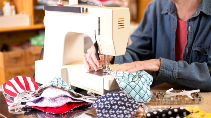 Woman's hands sewing maks