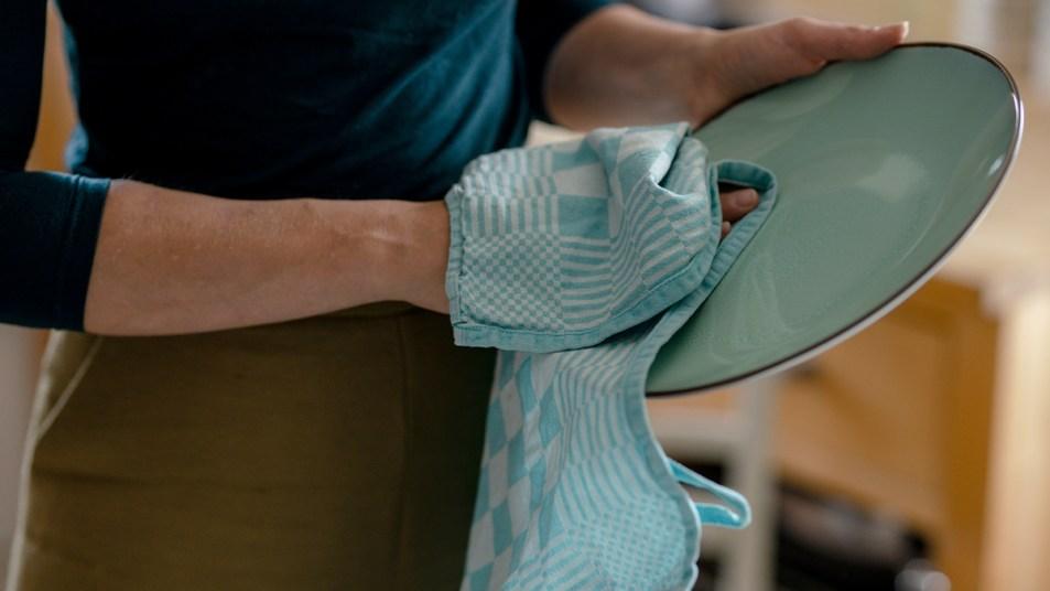 Woman Using a Kitchen Towel