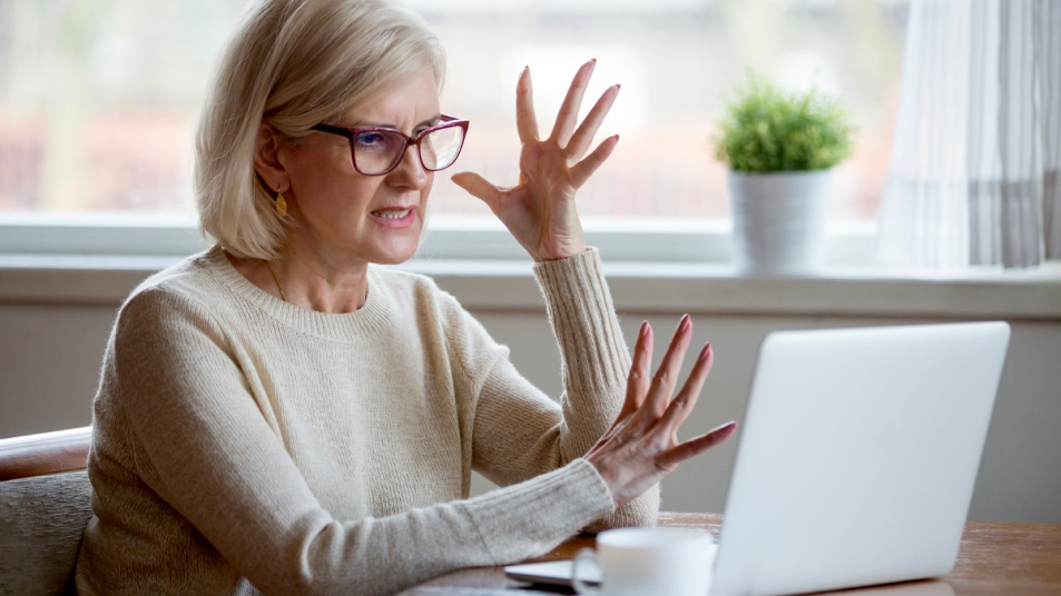 Woman irritated in front of laptop