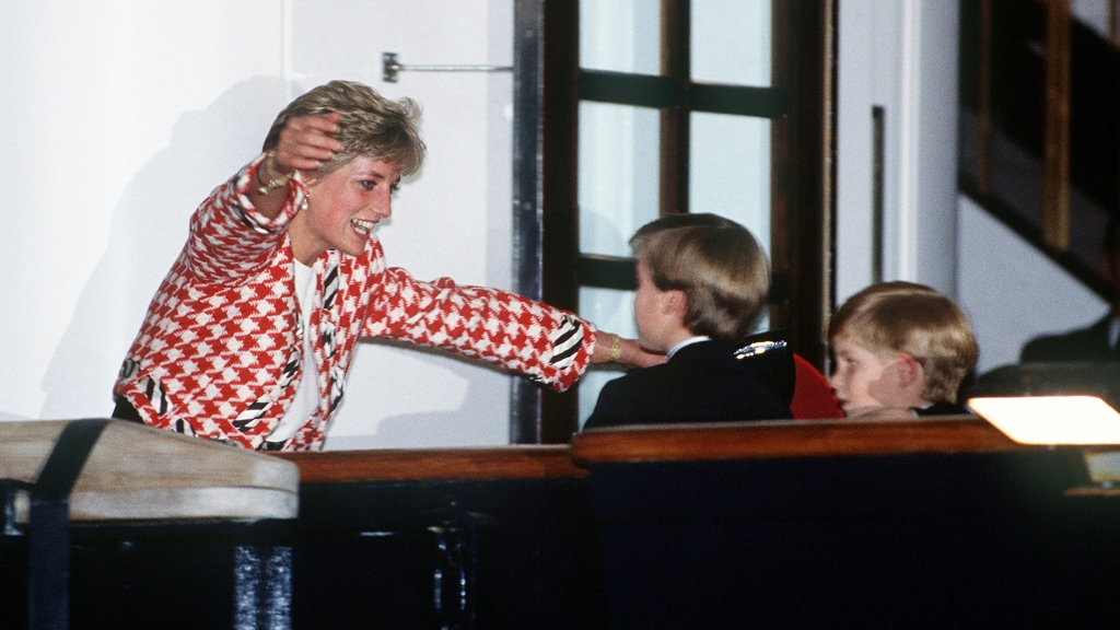 Princess Diana with arms out to hug young William and Harry