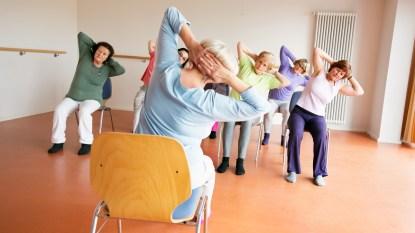 Group of women doing chair yoga