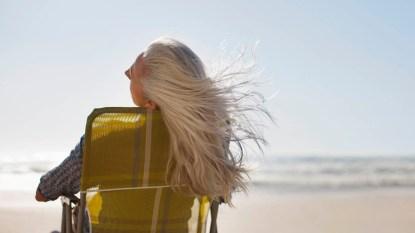 woman with gray hair on beach