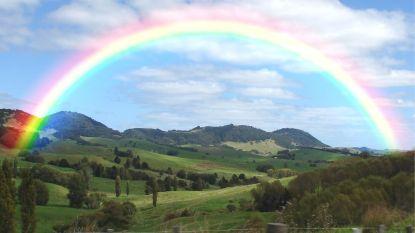 Rainbow over green hills