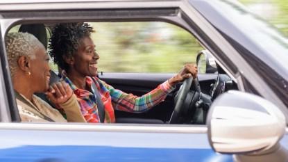 women on a road trip