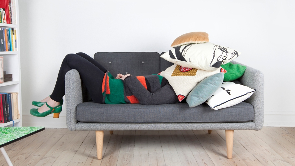 tired woman on sofa