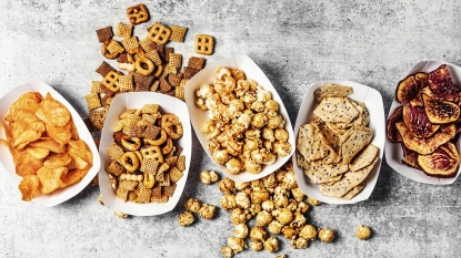 salty and sweet snacks spilling out of baskets
