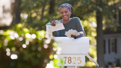 Woman grabbing her mail
