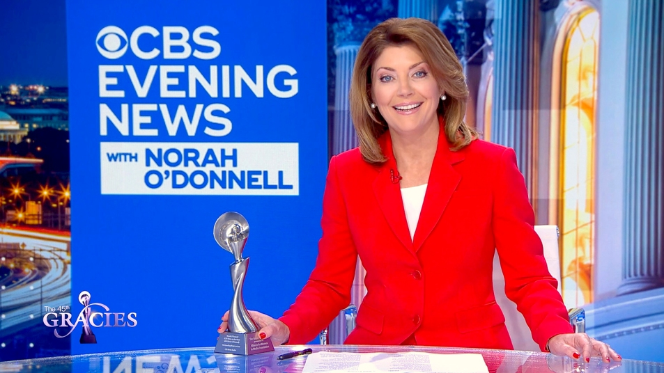 norah o'donnell behind anchor desk