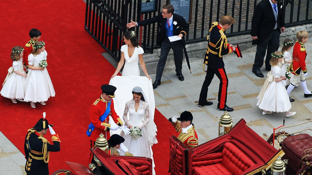 The couple getting ready to take a ride in the royal carriage